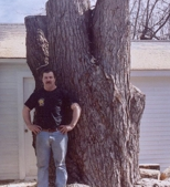 Andy in front of tree stump